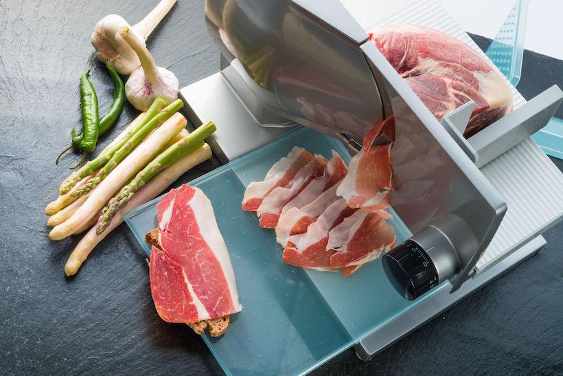 Meat slicing machine making prosciutto