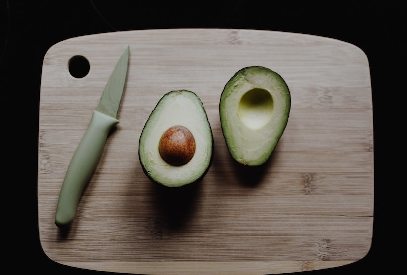 Paring knife with spear tip used to slice avocado