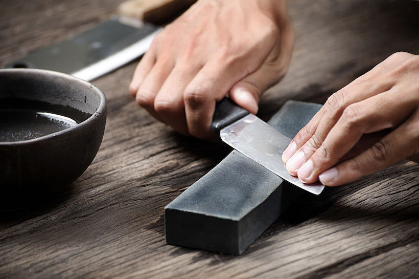 Sharpen knife with a whetstone