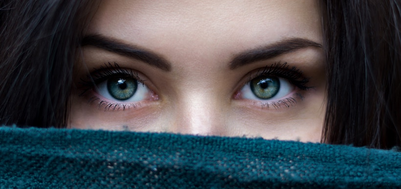 Lady with beautiful blue and green eyes