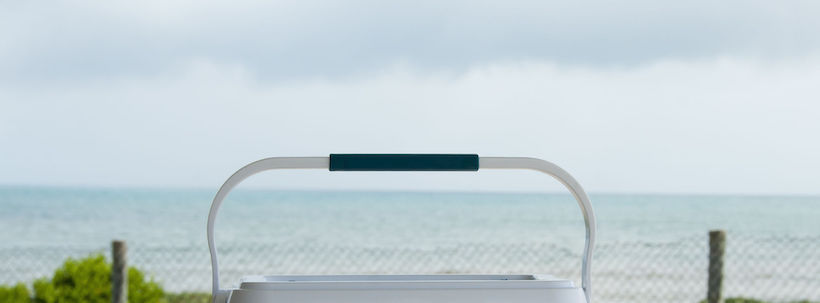 Handle of a cooler in front of the beach