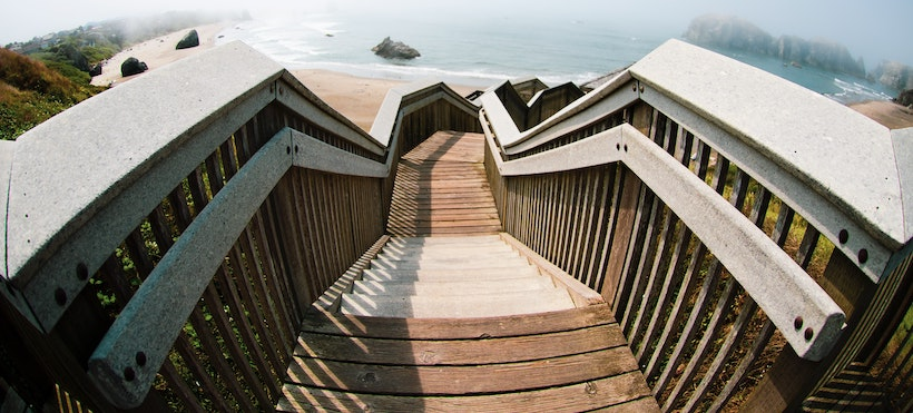 Staircase down to the beach with wooden rails