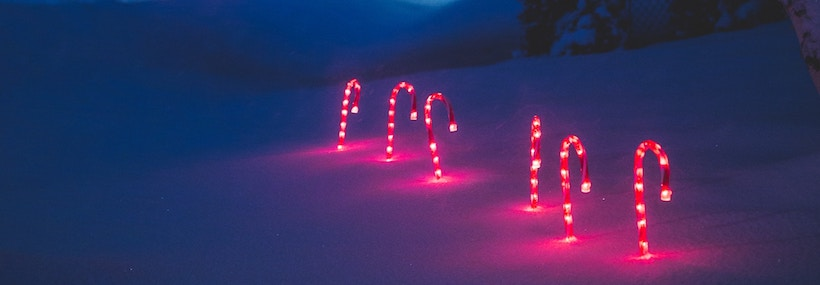 6 Candy Cane lawn ornaments in the snow