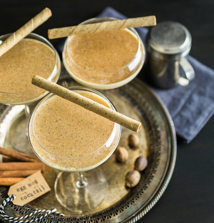 Tray of eggnog cocktails with cinnamon sticks