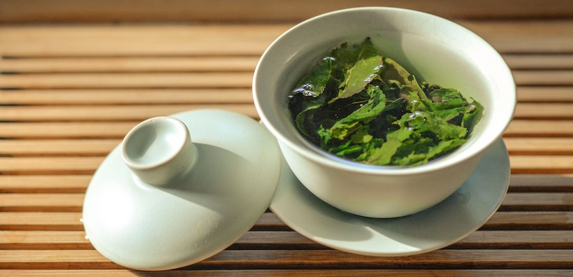 Green tea leaves in mug