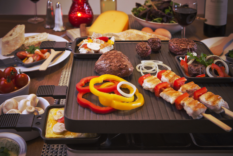 Swiss raclette grill with cooked meal on top