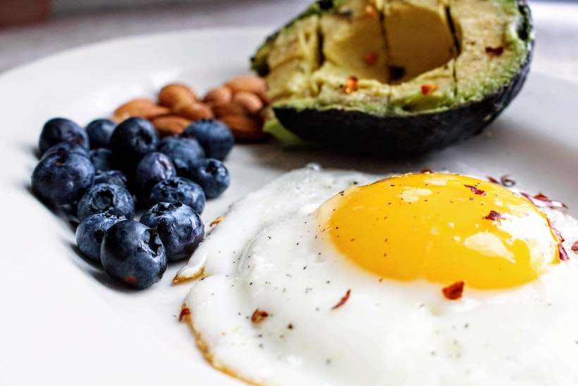 Egg with blueberries and avocado