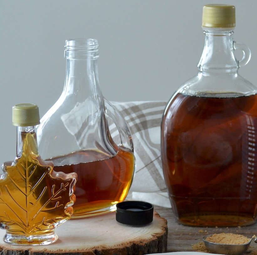 3 maple syrup bottles next to each other