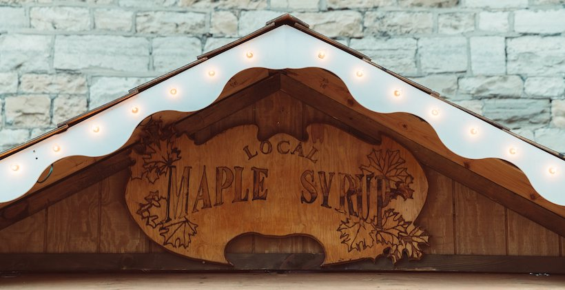 Wooden maple syrup sign above a door