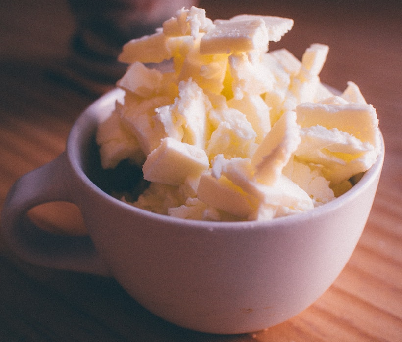 Mug containing pats of butter