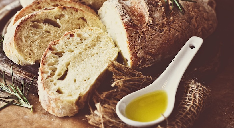 Loaf of bread and olive oil for dipping