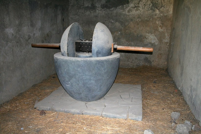 Picture of a stone olive press for making olive oil