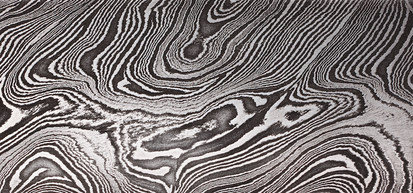 Background with pattern of Damask steel, close up