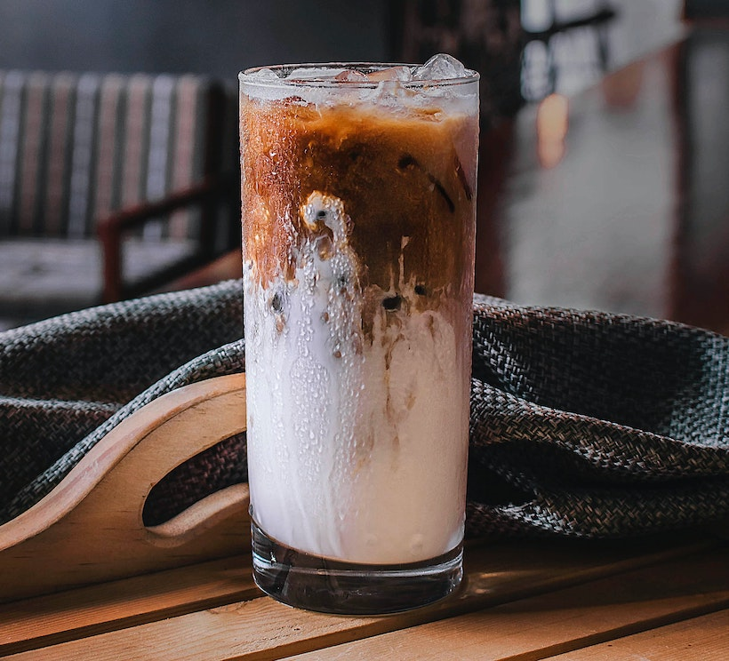 Milk mixing into cold brew coffee