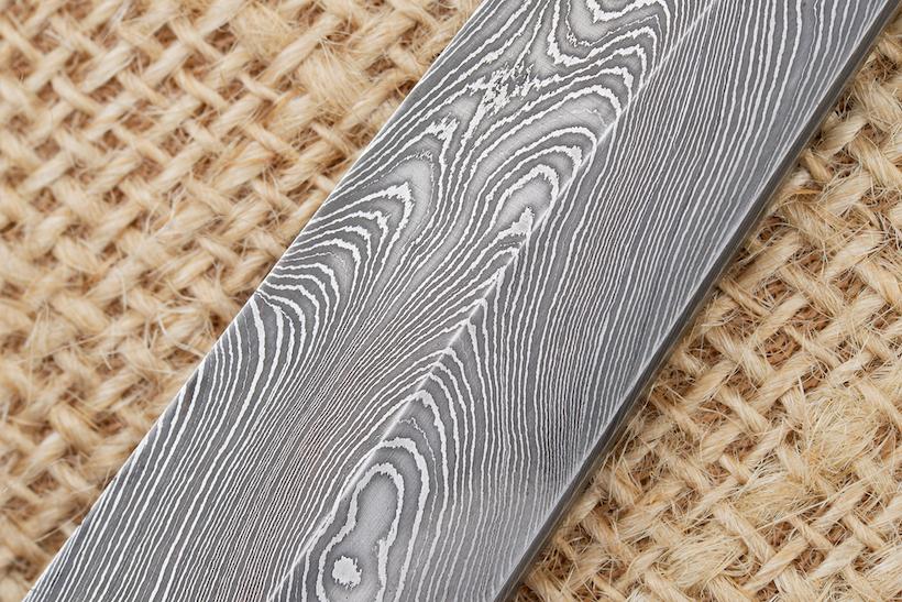 Traditional handmade Finnish knife blade made of damascus steel.