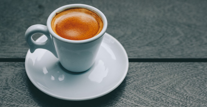 Ceramic white mug with espresso inside