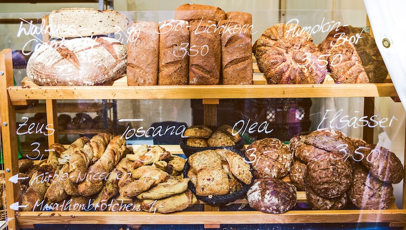 Bread at a bakery with wax crayon prices and names