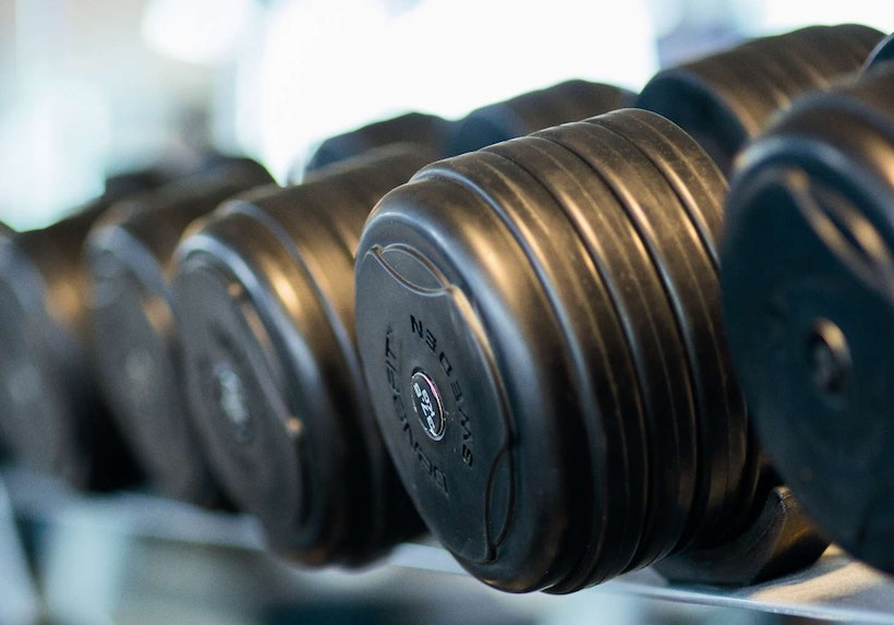 Rack foll of rubber dumbbells