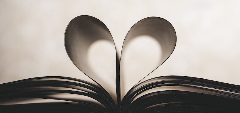 Book pages curled into a heart