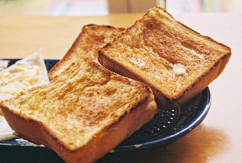 Butter on perfect golden brown toast
