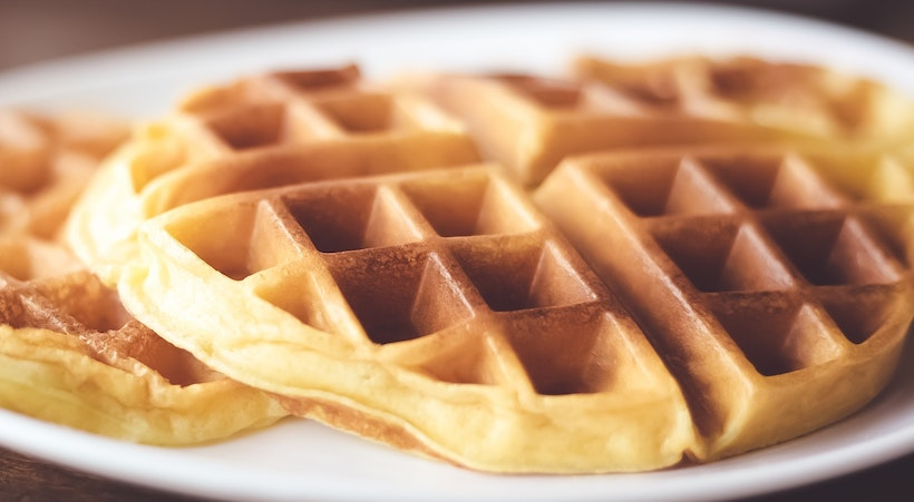 A closeup of golden brown waffles