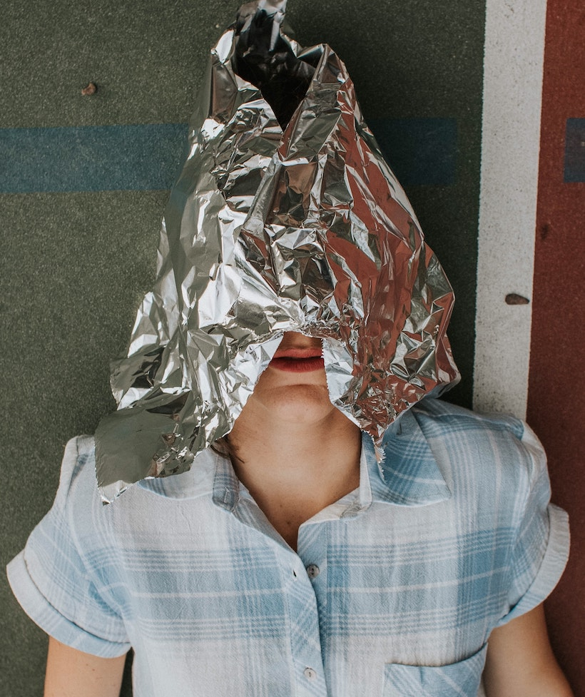 Lady wearing an aluminum or tin foil hat