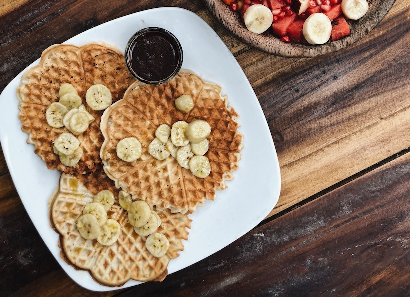 Waffles with bananas on top