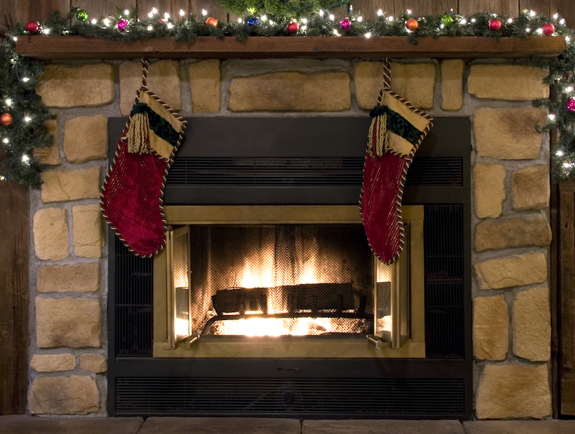 Two Christmas stockings hanging by the fireplace.
