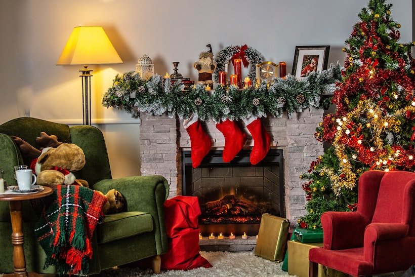 Decorated room with Christmas decorations and a lit fireplace