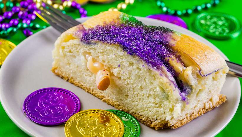 King cake slice with a plastic baby inside