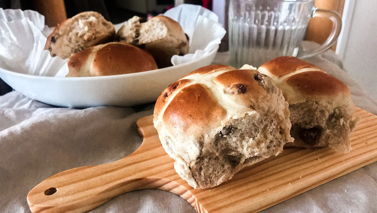 Hot cross buns on a cutting board