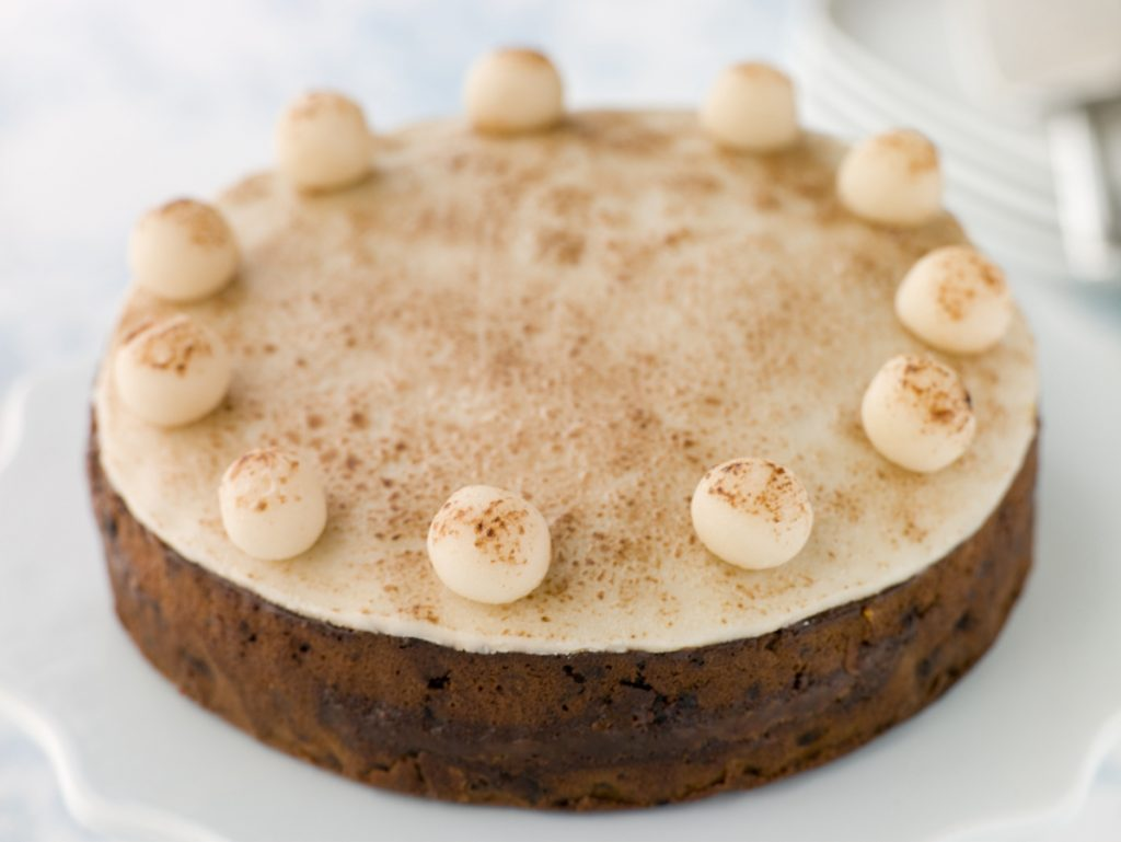 Whole simnel cake half in focus